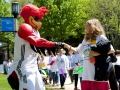 Clutch the Erie Blackhawks mascots greets students at the festival