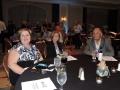 Diann Scott, Julie Storey, and Gary Boshart preparing for the Auction