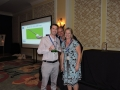Keith Swan recieves golf award from Buzz Mills and Erin Coffman