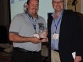 Matt Servant recieves golf award from Buzz Mills