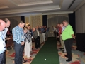 Members line up to watch a possible $20,000 putt