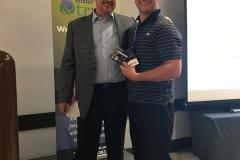 Buzz Mills presents Matt Andersson with winning $750 gift card for Rocket Launcher Raffle