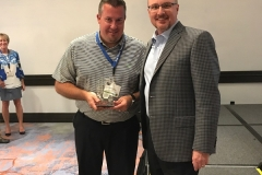 Matt Servant accepts the golf award for Closest to the Pin from Buzz Mills, WWT President
