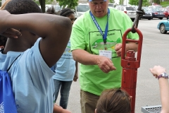 Ron Holt explaing drill bits to students