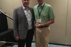 Buzz Mills congratulates Dave Rutz for Longest Drive