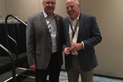 Buzz Mills congratulates Gerry Duggan for Closest to the Pin