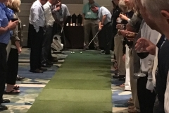 Dan Story tees up for the $10,000 putt