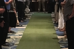 Steve Anderson tees up for the $10,000 putt
