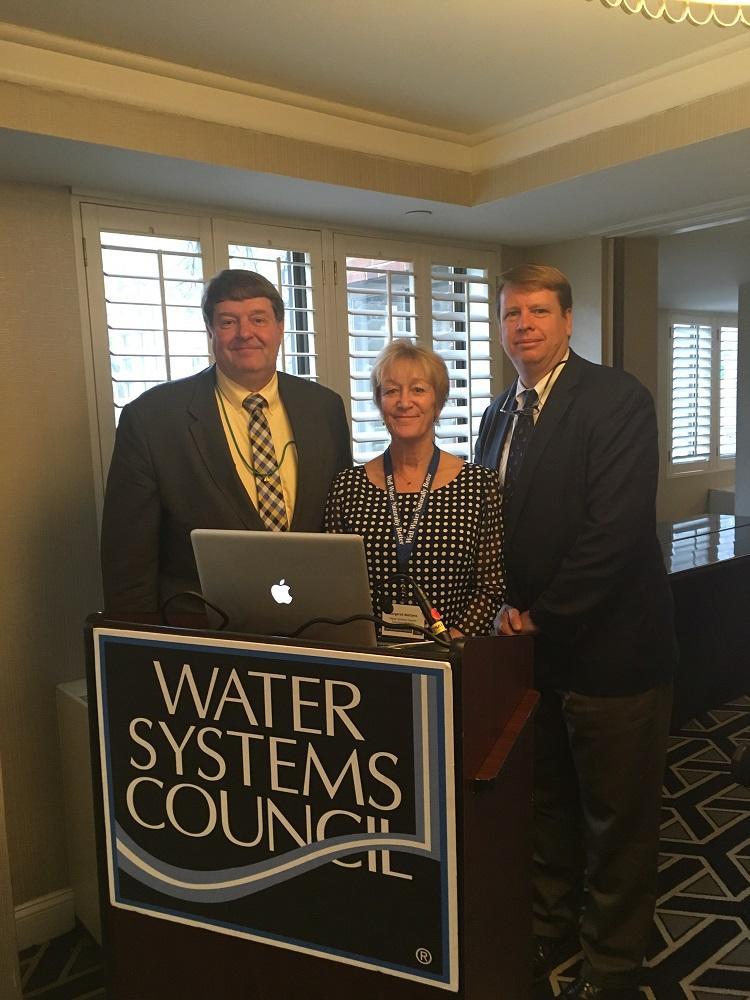 Lee Forsgren, Margaret Martens, and Jeff More address the WSC Members' meeting