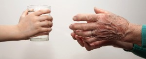 young and old hands with water glass2